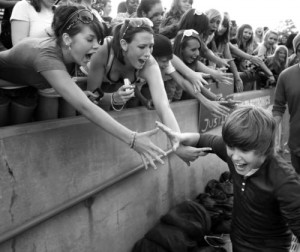 justin bieber with fans 300x252 It's Justin Bieber's Birthday! Never Say Never Star Turns 17